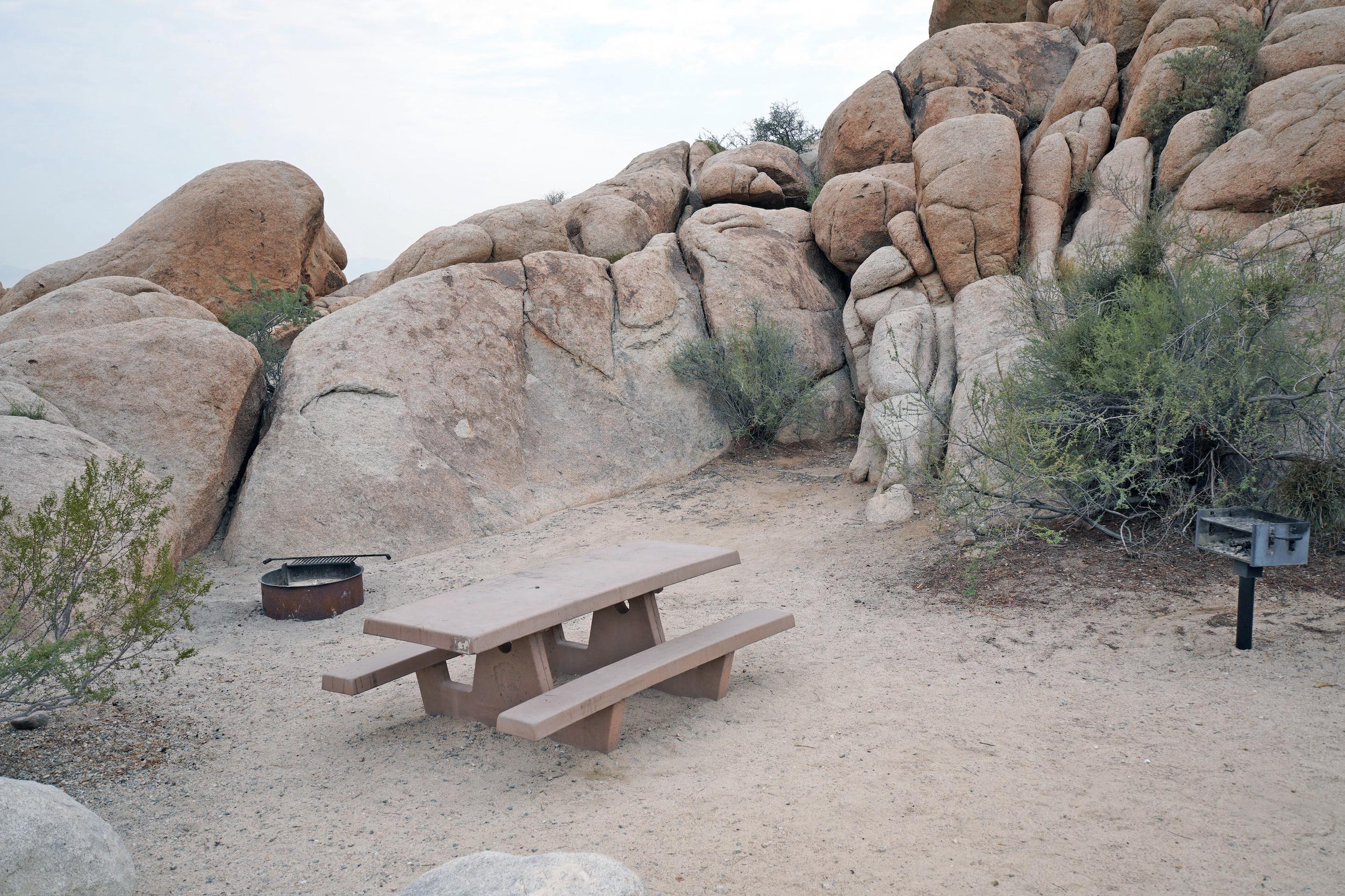 Campsite  with picnic table surrounded by boulders.Campsite.