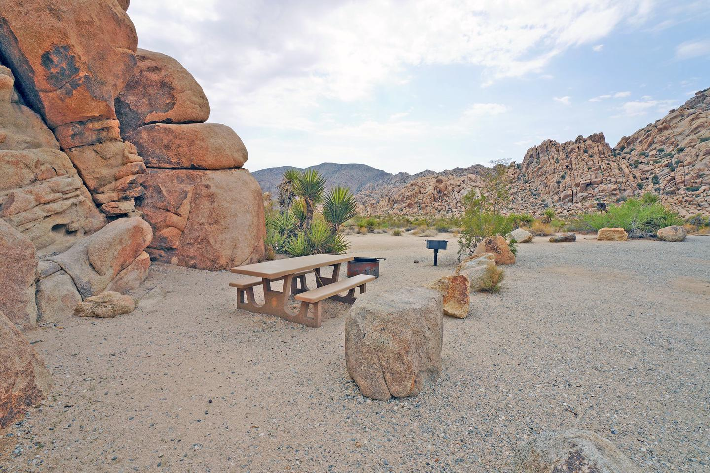 Campsite  with picnic table surrounded by boulders .Campsite.