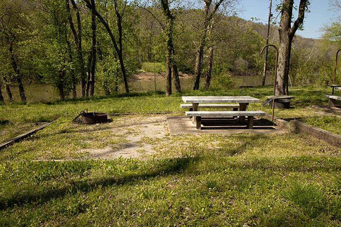 Campsite 3, located with a view of the Green River the campsite has a picnic table and fire ring. Campsite 3, located with a view of the Green River the campsite has a picnic table and fire ring.