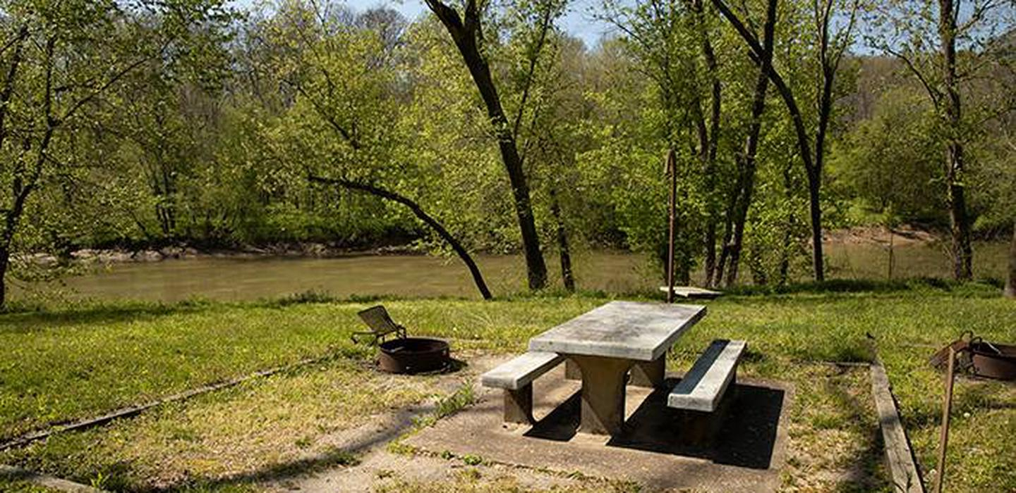 Campsite number 4 is located with a view of the Green River, the campsite has a picnic table and fire ring.