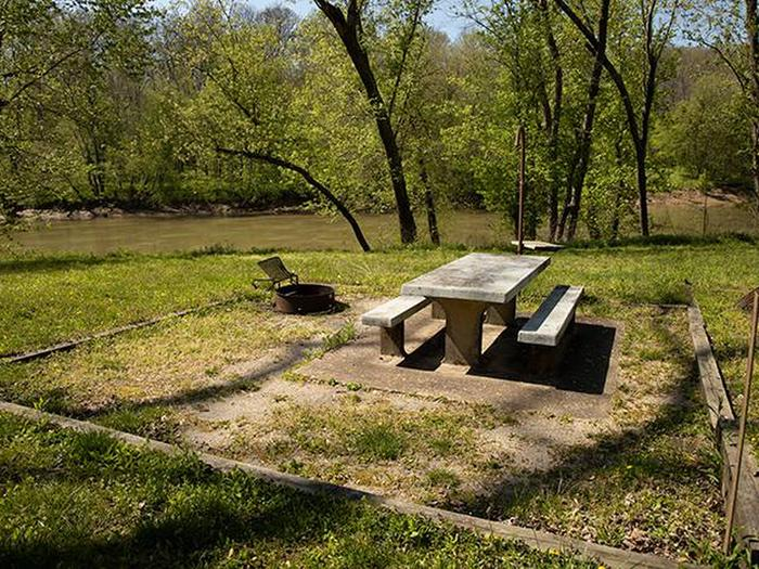 Campsite number 4 is located with a view of the Green River, the campsite has a picnic table and fire ring. Campsite number 4 is located with a view of the Green River, the campsite has a picnic table and fire ring.