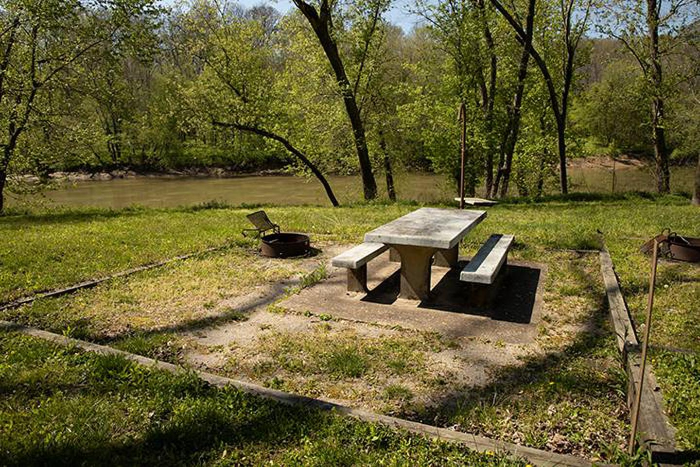 Campsite 4, located along the Green River.  This campsite has a picnic table and fire ring. Campsite number 4 is located with a view of the Green River, the campsite has a picnic table and fire ring.