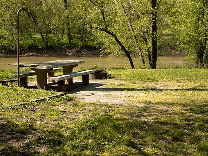 Campsite number 5 is located along the river bank of the Green River, the campsite has a picnic table and fire ring. Campsite number 5 is located along the river bank of the Green River, the campsite has a picnic table and fire ring.