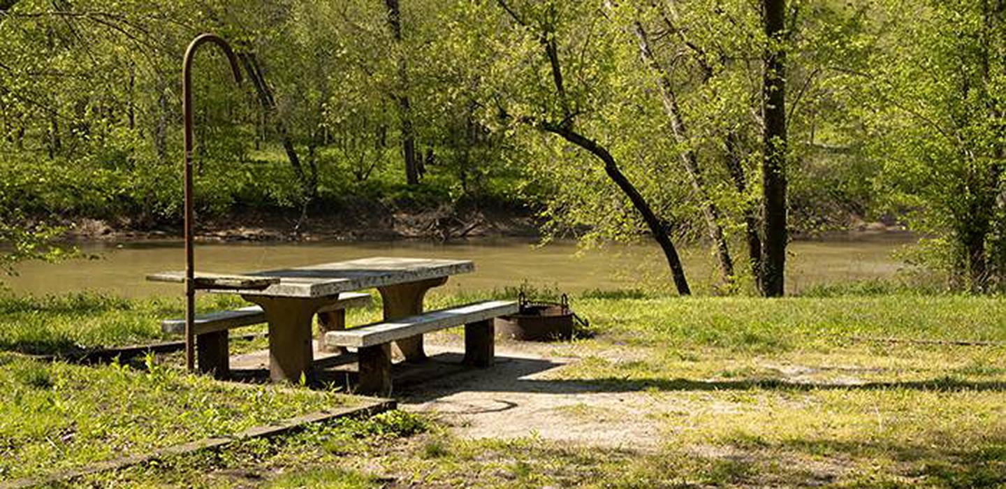 Campsite number 5 is located along the river bank of the Green River, the campsite has a picnic table and fire ring.
