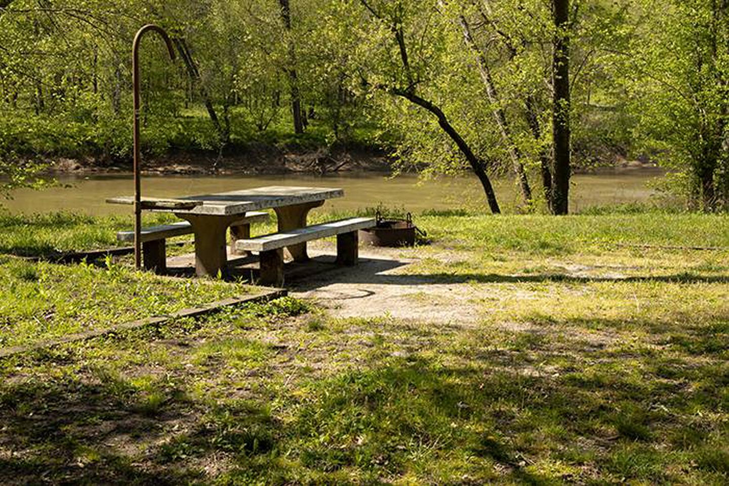 Campsite 5, located along the river bank of the Green River, the campsite has a picnic table and fire ring. Campsite 5, located along the river bank of the Green River, the campsite has a picnic table and fire ring.