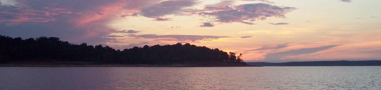 A beautiful sunset along the southern shore of Sardis Lake. Sunset at Sardis Lake
