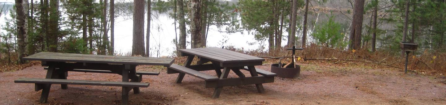Site 8 provides campers with a nice view of the lake, two picnic tables, fire pit, and a grill.Site 8 Lake View