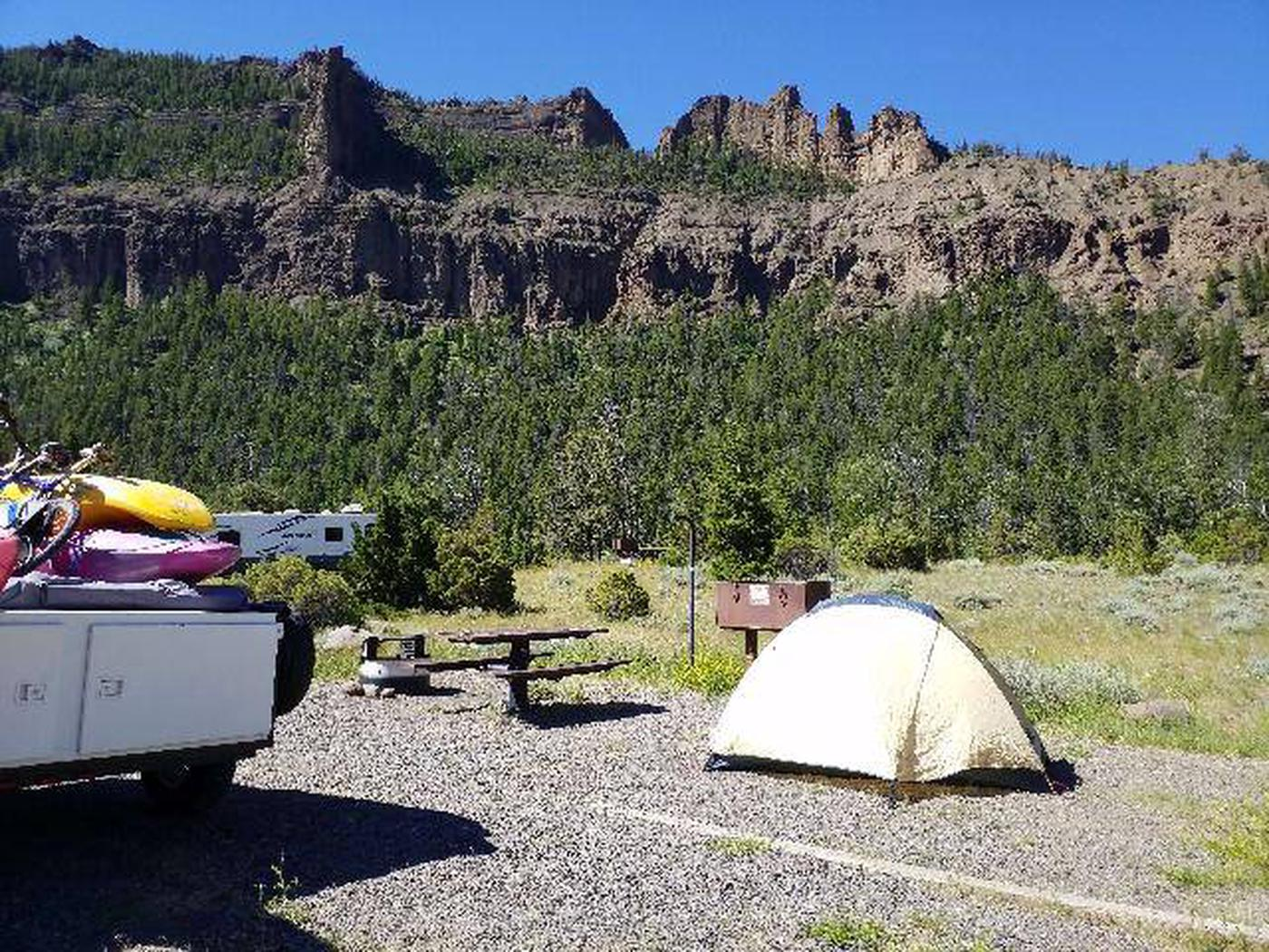 Rex Hale Campground campsite area with cliffs in background