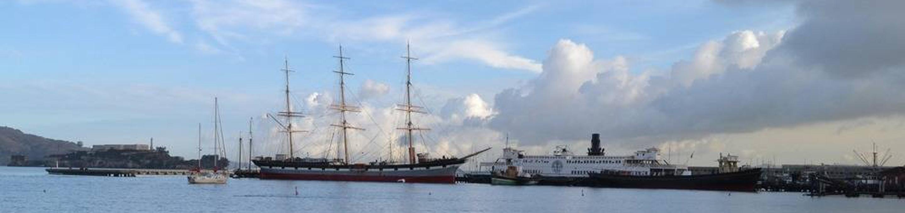 Three-masted, steel-hulled, square-rigged cargo ship Balclutha from Hyde Street PierBalclutha and Clouds on October Morning