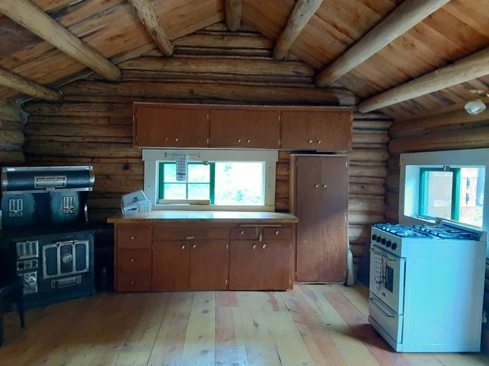 Kitchen areaCounter tops, cabinets and a propane stove