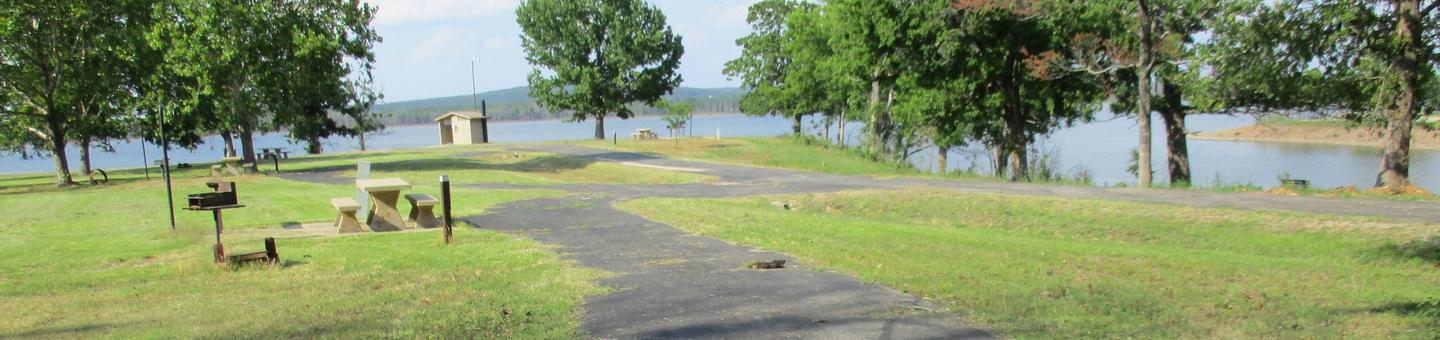 Site 1 is a pull through with concrete picnic table.Site 1 offers a long pull through drive with a lake view and easy access to the vault toilet.