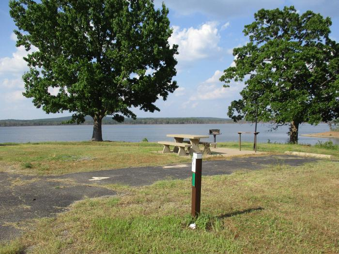 Site 4 offers a nice lake view.Site 4 has a large flat grassy area for easy tent set up.