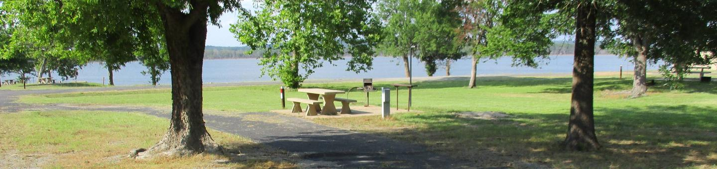 Site 5 offers a pull through drive with partial shade.Site 5 offers a long drive with an unobstructed view of the lake.