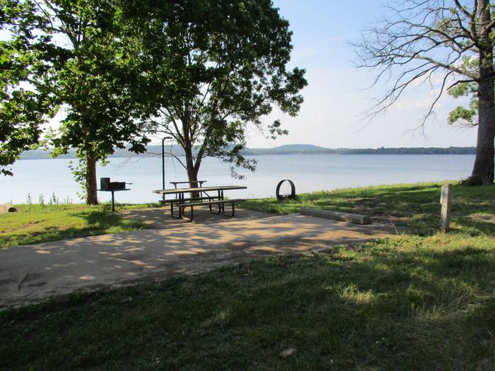 Site 26 offers a great lake view.Site 26 offers a metal picnic table, pedestal grill, utility table, lantern hook and fire ring.