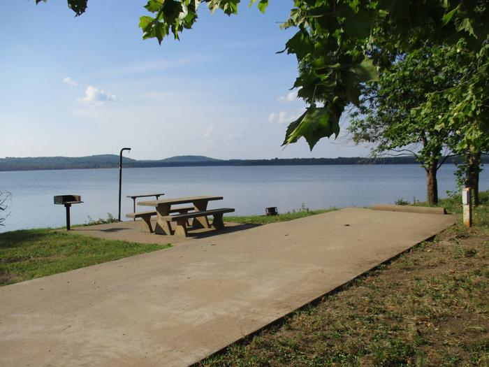 Site 27 offers an unobstructed view of the lake.Site 27 offers a concrete drive with easy access to the water to moor boats.