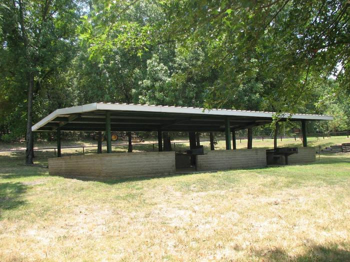 Wildwood offers a group day use shelter.The Wildwood Shelter offers concrete and metal picnic tables, as well as, two pedestal grills.  The horseshoe pit and volleyball poles are located near the shelter.