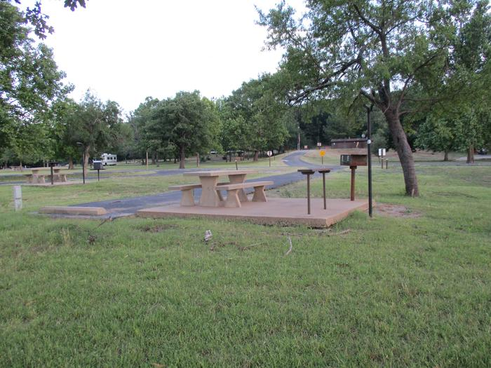Wildwood - Site 17Site 17 offers a concrete picnic table, pedestal grill, utility table, lantern holder and 30 amp electric.