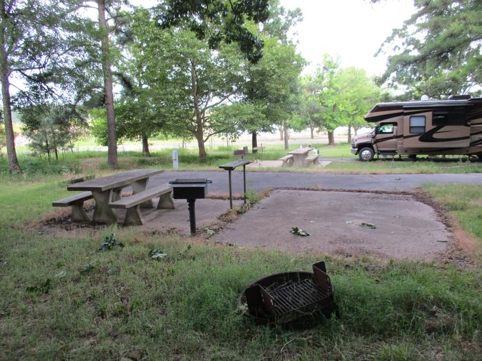 TFS - 13Site 13  offers a concrete picnic table, pedestal grill, utility table, fire ring and 30 amp electric.  The site has a limited view of the water, but offers excellent shade in the afternoon.