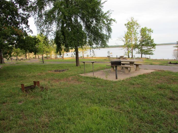 TFS - Site 22Site 22 offers a concrete picnic table, utility table, pedestal grill and fire ring.  It is within a short walking distance of the water to moor boats or swim.