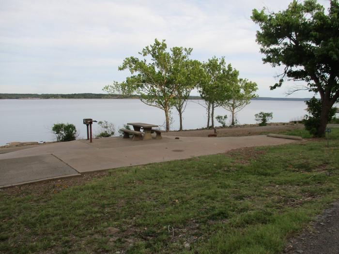 Site 53 - TFSSite 53 offers a concrete parking pad with an asphalt drive.  It offers a great lake view.