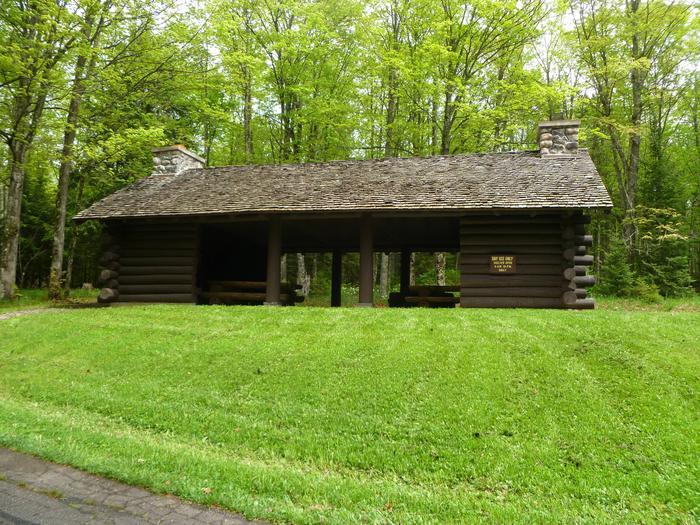 Lake Ottawa Campground Picnic ShelterLake Ottawa Campground  offers a picnic shelter with two stone fireplaces and original log picnic tables.