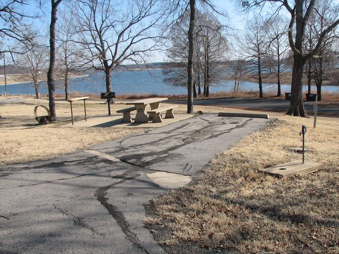 TFS - Site 25Site 25 offers a concrete picnic table, pedestal grill, utility table, fire ring and 30 amp electric pedestal.