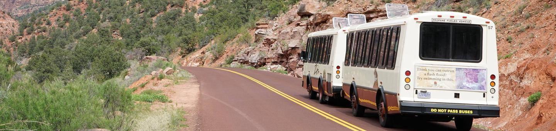 Zion Shuttle Bus Heading up Canyon Shuttle bus in Zion Canyon