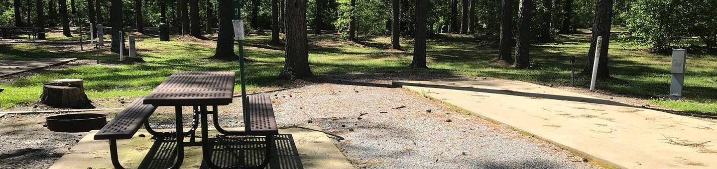 Shaded Class A Campsite #3Shaded Class A Campsite #3. RV pad, water, and 20/30/50 AMP electric hook-ups as well as basic campsite amenities including a picnic table, lantern post, fire ring, trash can and grill.
