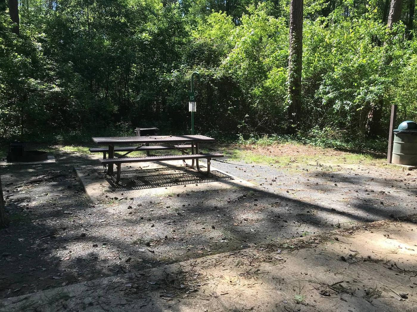 Shaded Class A Campsite 15Shaded Class A Campsite #15. RV pad, water, and 20/30/50 AMP electric hook-ups as well as basic campsite amenities including a picnic table, lantern post, fire ring, trash can and grill.