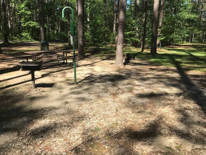 Shaded Class A Campsite 16Shaded Class A Campsite #16. RV pad, water, and 20/30/50 AMP electric hook-ups as well as basic campsite amenities including a picnic table, lantern post, fire ring, trash can and grill.