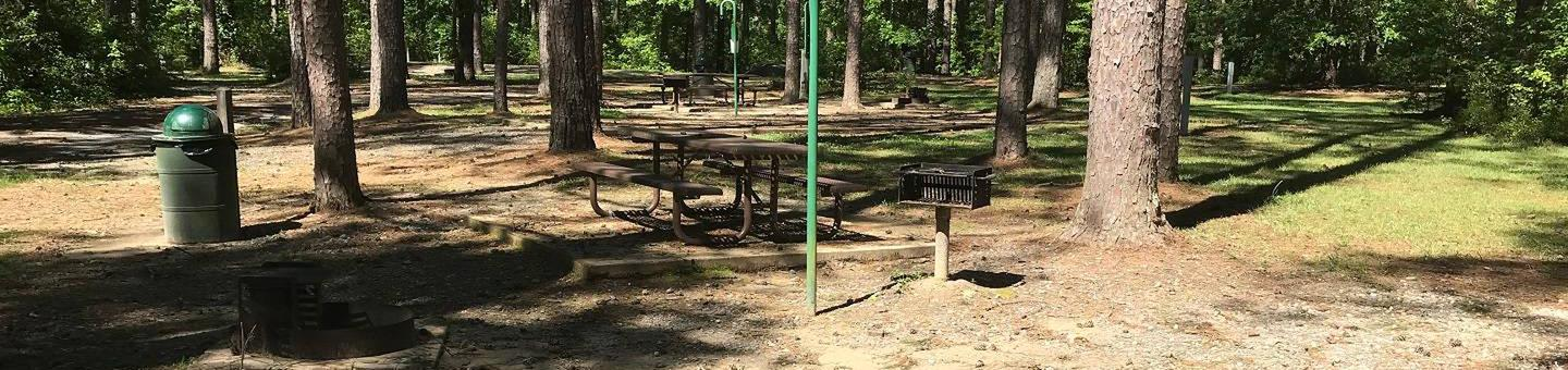 Shaded Class A Campsite #18Shaded Class A Campsite #18. RV pad, water, and 20/30/50 AMP electric hook-ups as well as basic campsite amenities including a picnic table, lantern post, fire ring, trash can and grill.