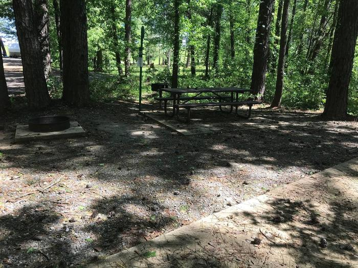 Shaded Class A Campsite 20Shaded Class A Campsite #20. RV pad, water, and 20/30/50 AMP electric hook-ups as well as basic campsite amenities including a picnic table, lantern post, fire ring, trash can and grill.