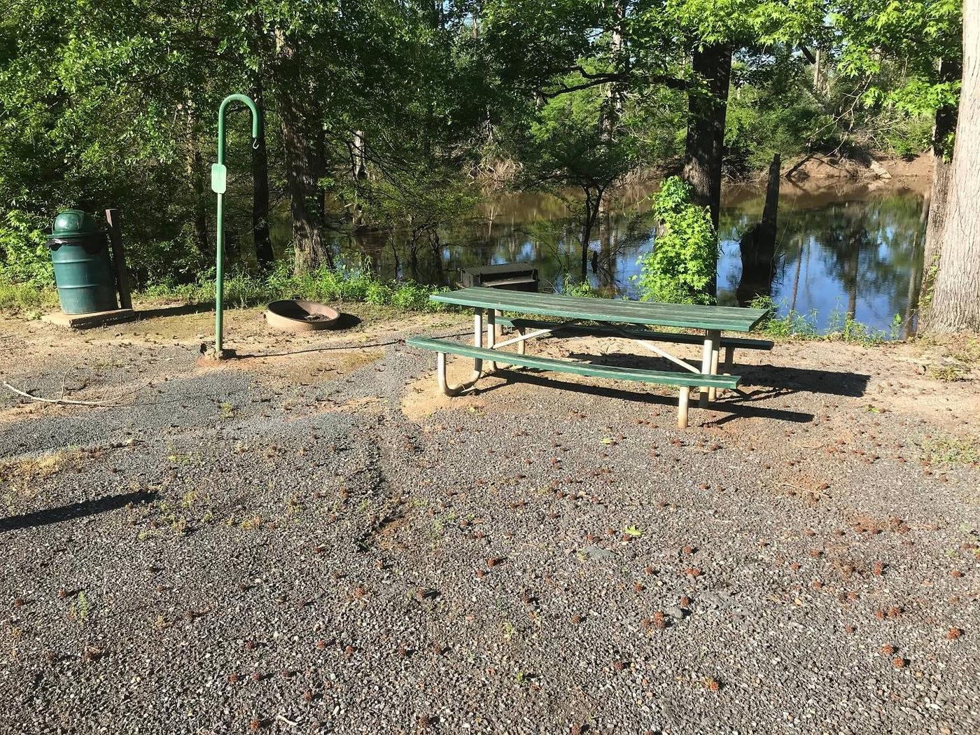 Campsite #2.Campsite #2. Tent site with the following amenities: fire-pit, grill, picnic table, lantern pole, trash can.  Located along bayou.