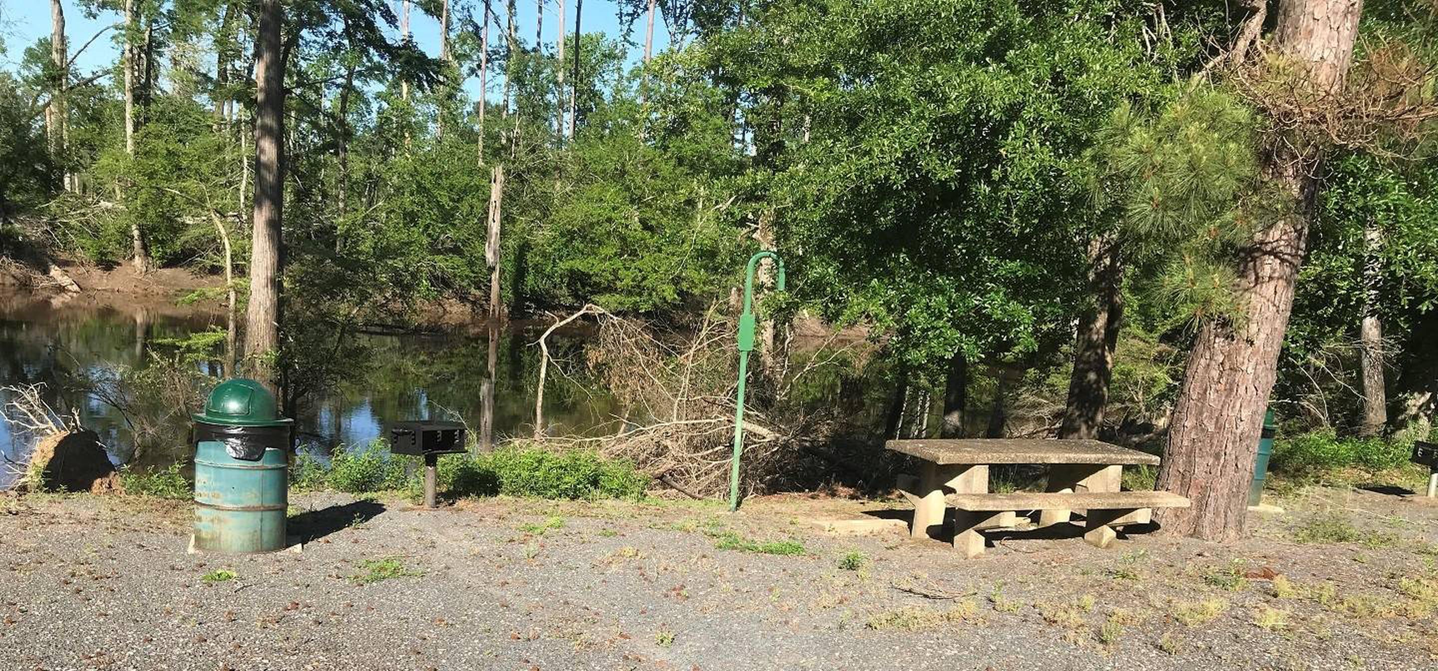 Campsite #3.Campsite #3. Tent site with the following amenities: fire-pit, grill, picnic table, lantern pole, trash can.  Located along bayou.