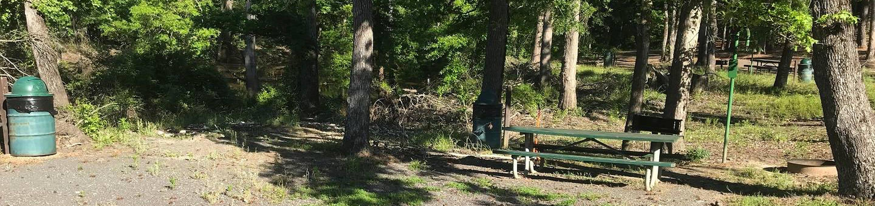 Campsite #5Campsite #5. Tent site with the following amenities: fire-pit, grill, picnic table, lantern pole, trash can.  Located along bayou.