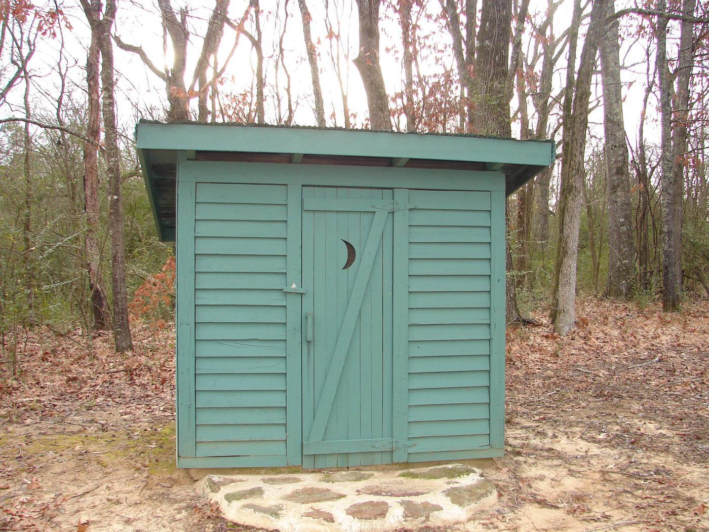 Old fashion outhouse.Outhouse