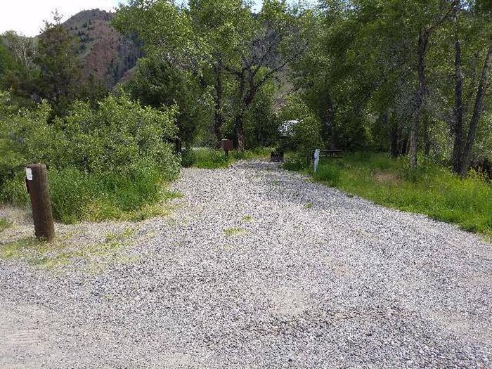 Wapiti Campsite 9 - Parking Area, gravel, trees in backgroundWapiti Campsite 9 - Parking Area