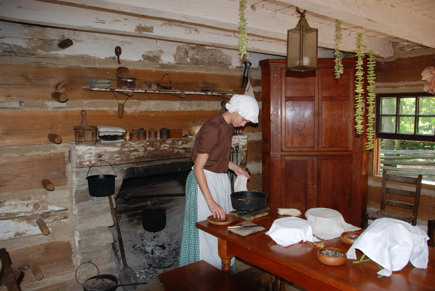 Cabin at Living Historical FarmPark rangers depict pioneer life in the 1820s.