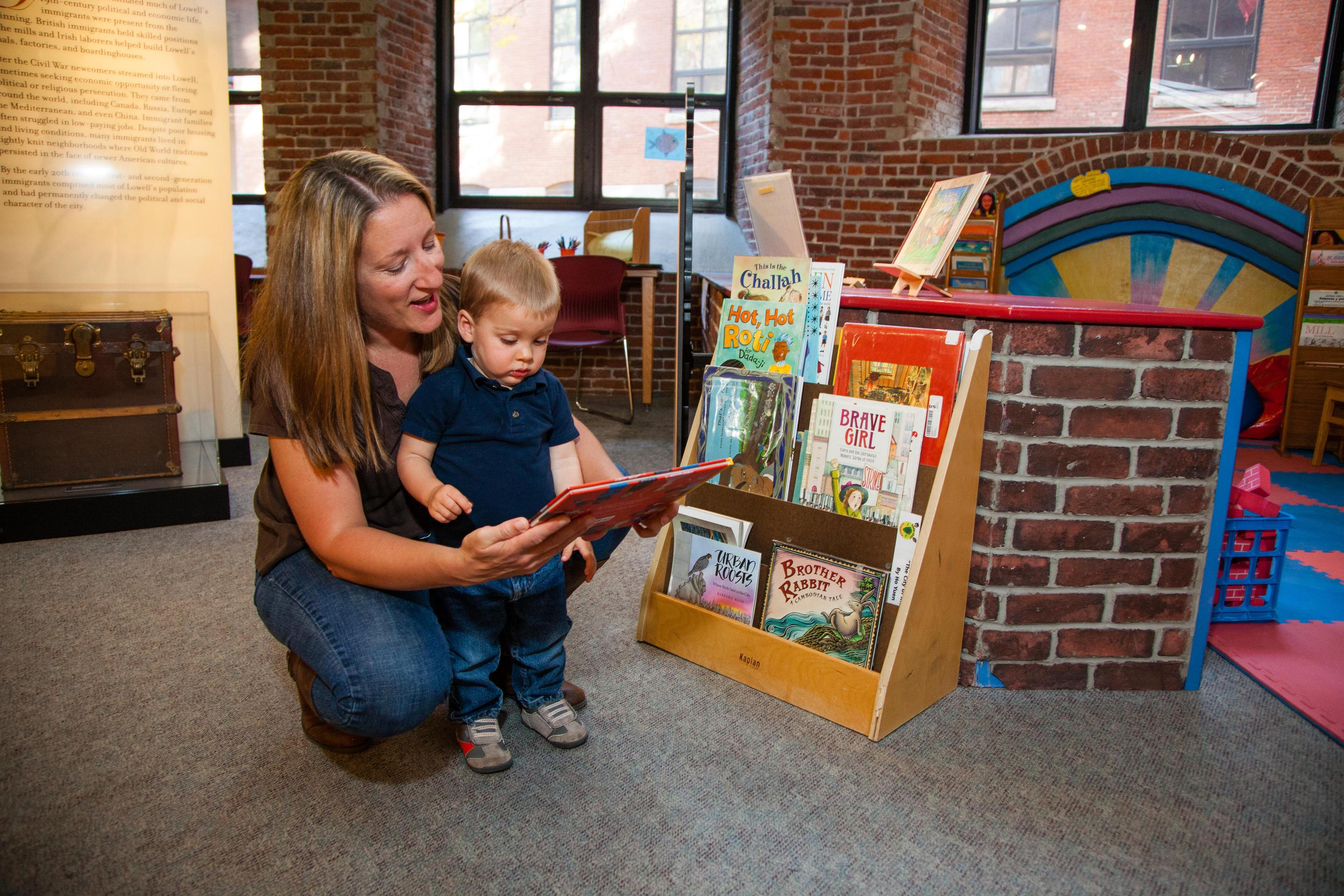 A mother and son read together in the Children's Corner