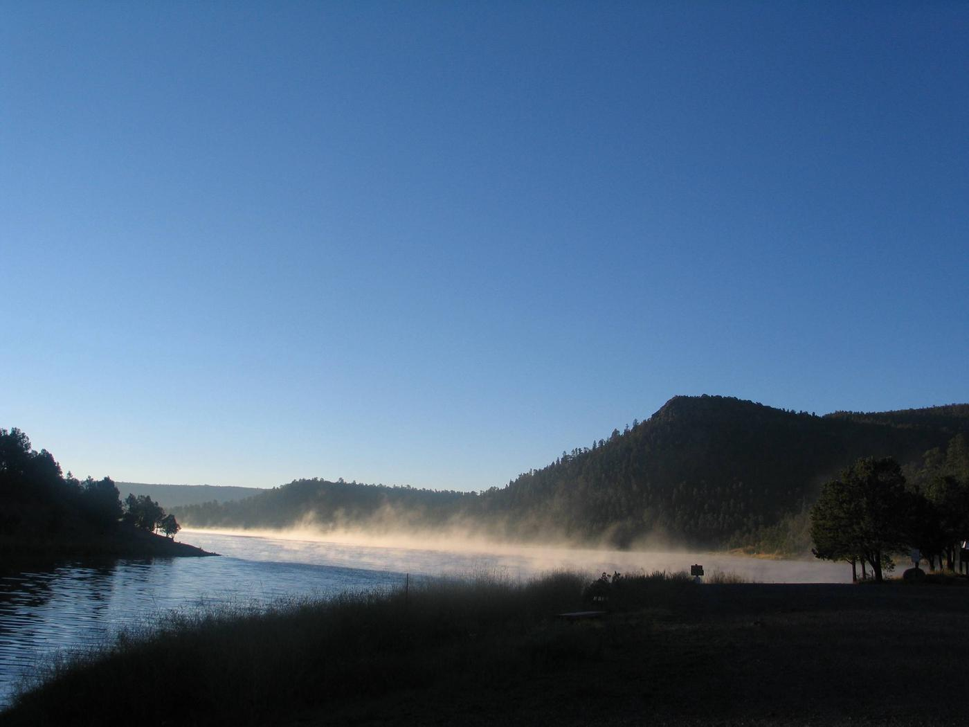Landscape near Quemado Lake showing mist rising off lake