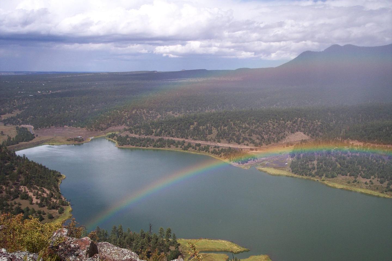 Landscape near Quemado Lake showing rainbow over lake