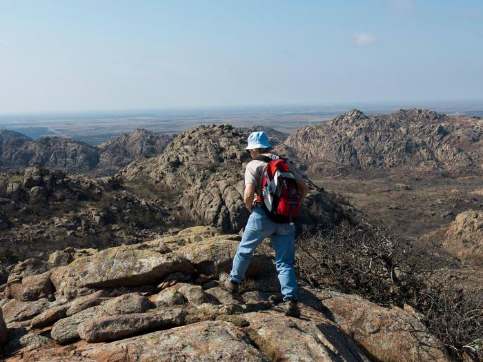 A hiker explores the geology of the area.
