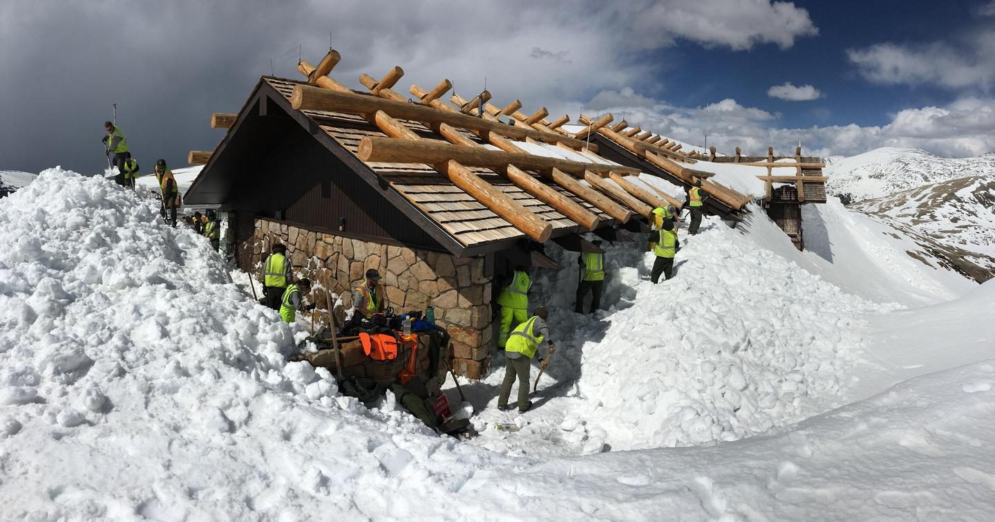 Digging Out the Alpine Visitor CenterThe Alpine Visitor Center is covered by snow all winter long and has to be dug out every May.