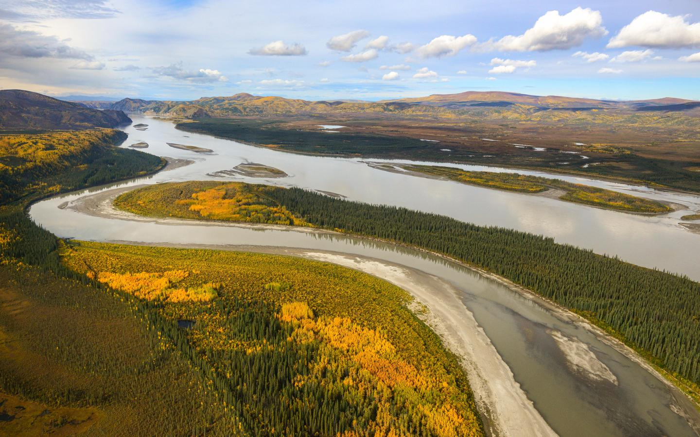 Aerial view of the Yukon RiverThe Yukon River is a vast body of water that has carved its path into the landscape over millions of years.