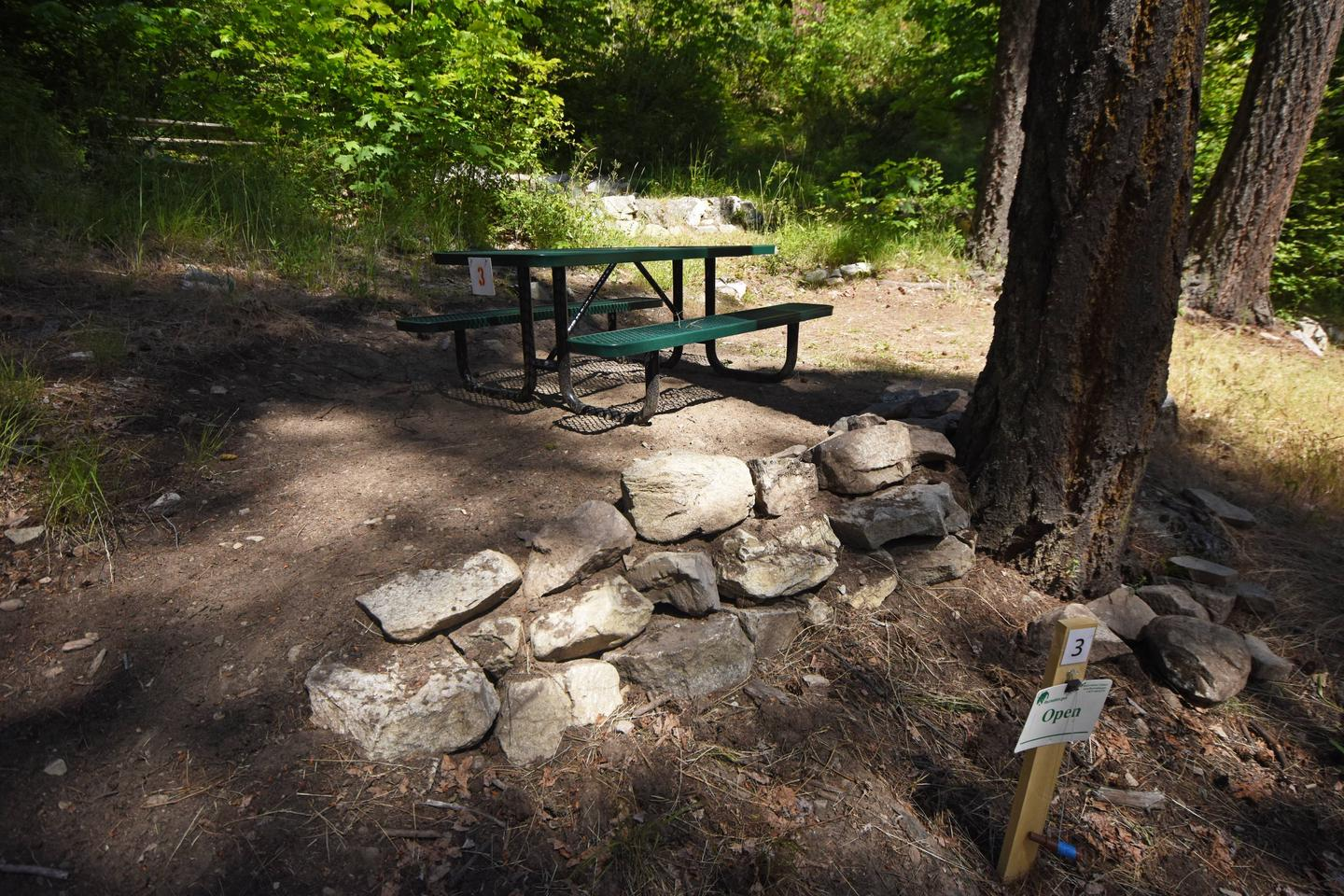 View of Lakeview campsite 3 with picnic table and tent pads.Lakeview Site 3