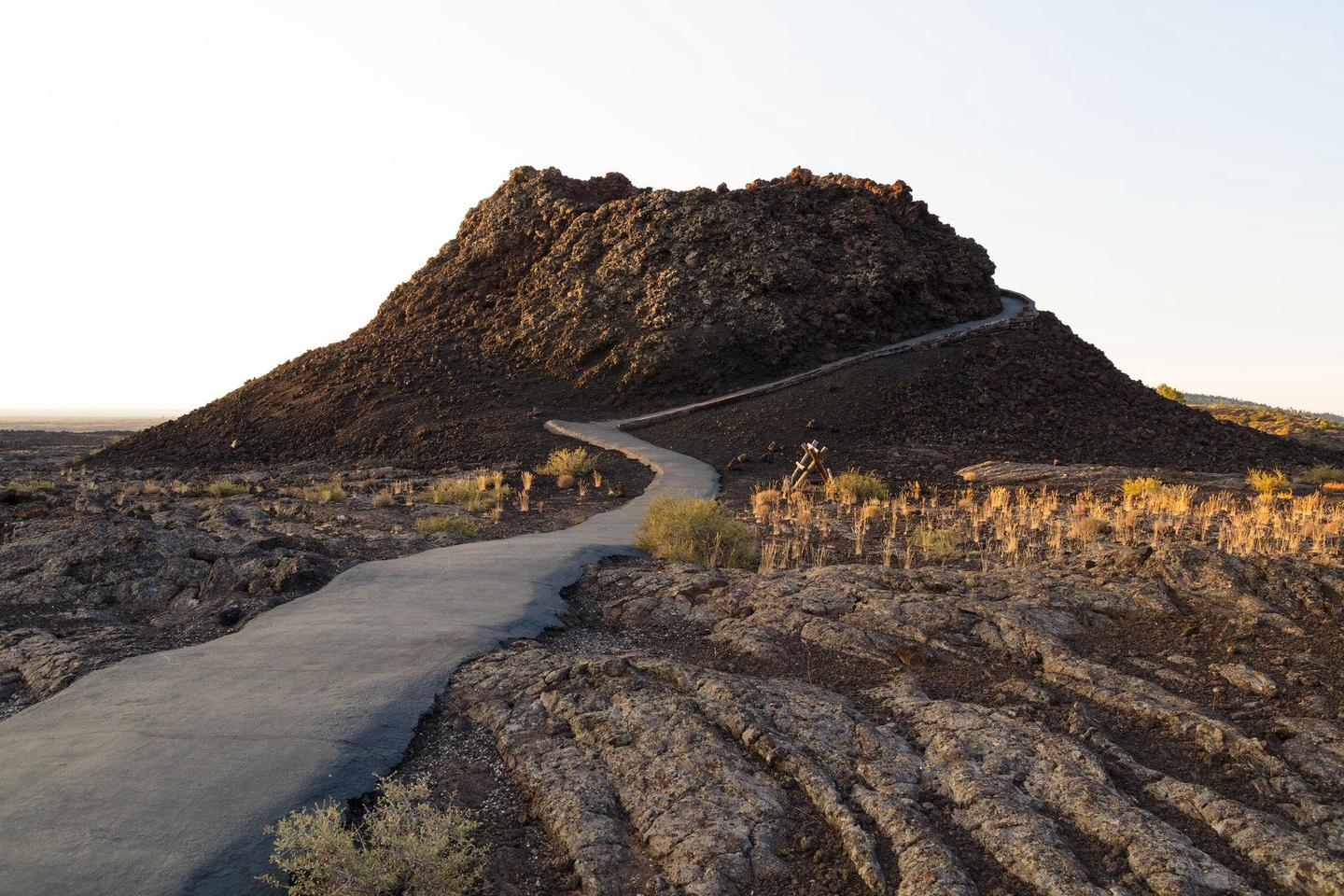 Explore Craters on FootTrails at Craters, like the Spatter Cone Trail, allow visitors to explore young volcanic features like spatter cones, cinder cones, and lava fields.