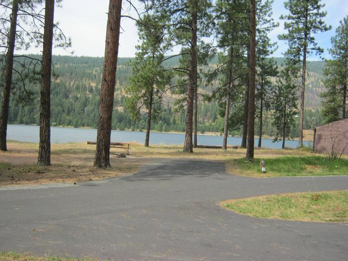 Front view of site 9Site 9, Back In, Pine trees and lake in background