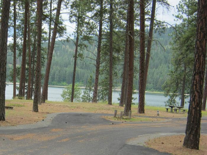 Pine trees and lake in the back dropPull through paved parking