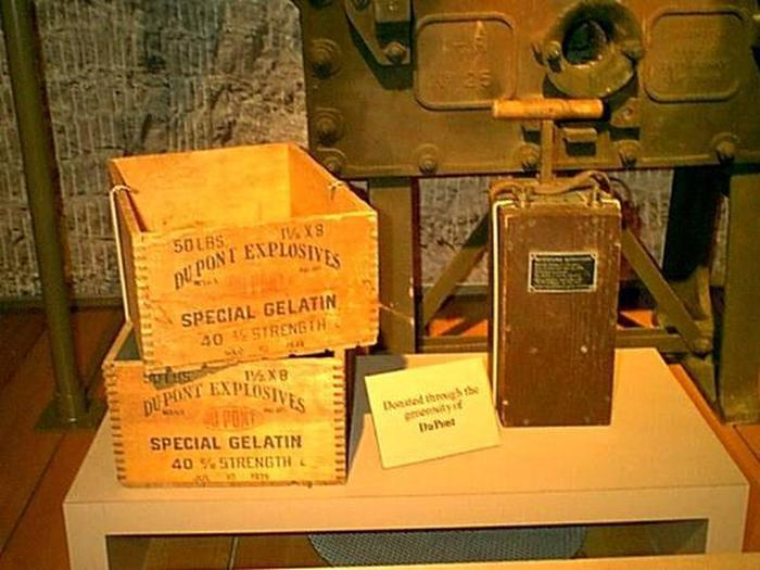 Dynamite Boxes and Blasting MachinePhoto of two wooden dynamite storage boxes and a blasting machine used to detonate explosive charges.