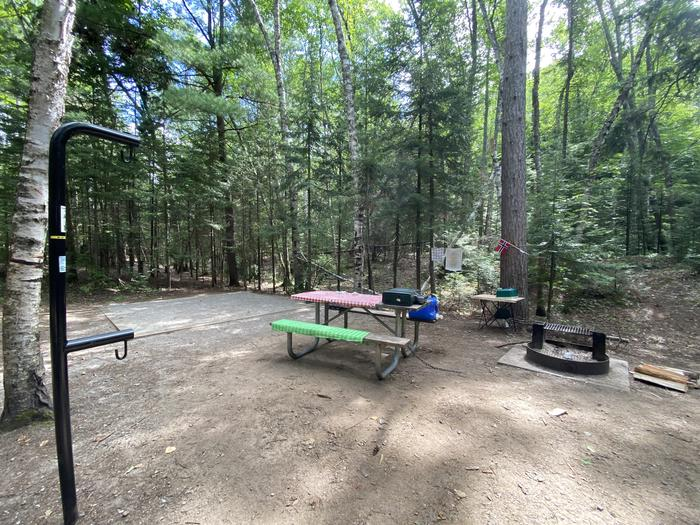 Picnic table, lantern pole, fire ring and tent pad